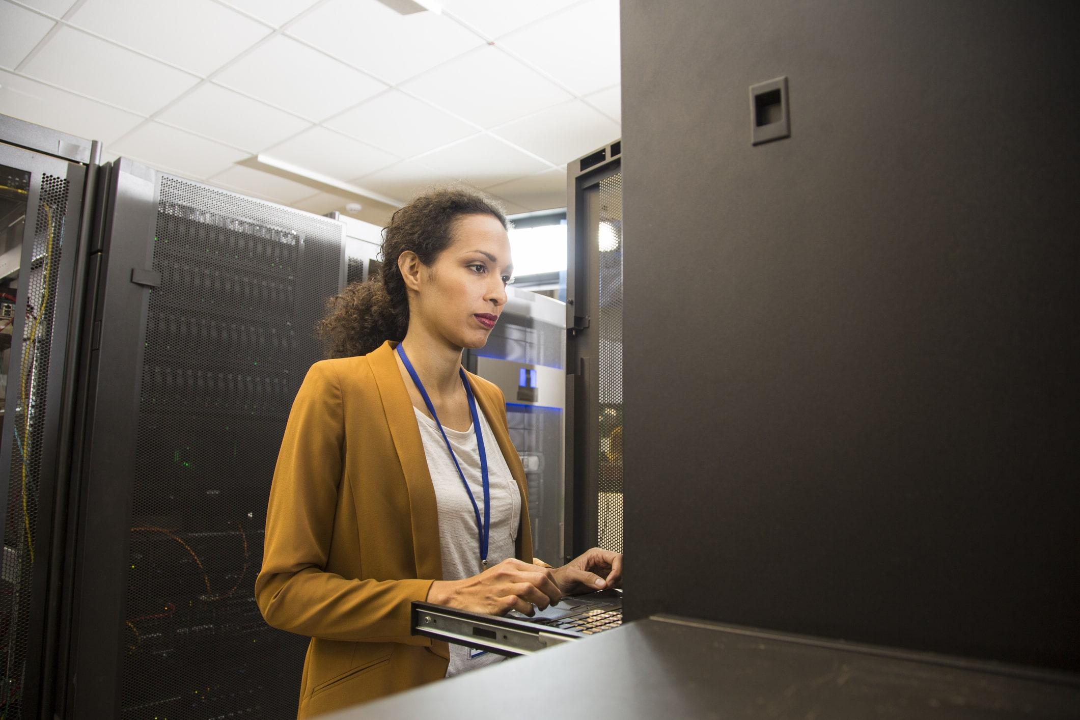 female network administrator in server room