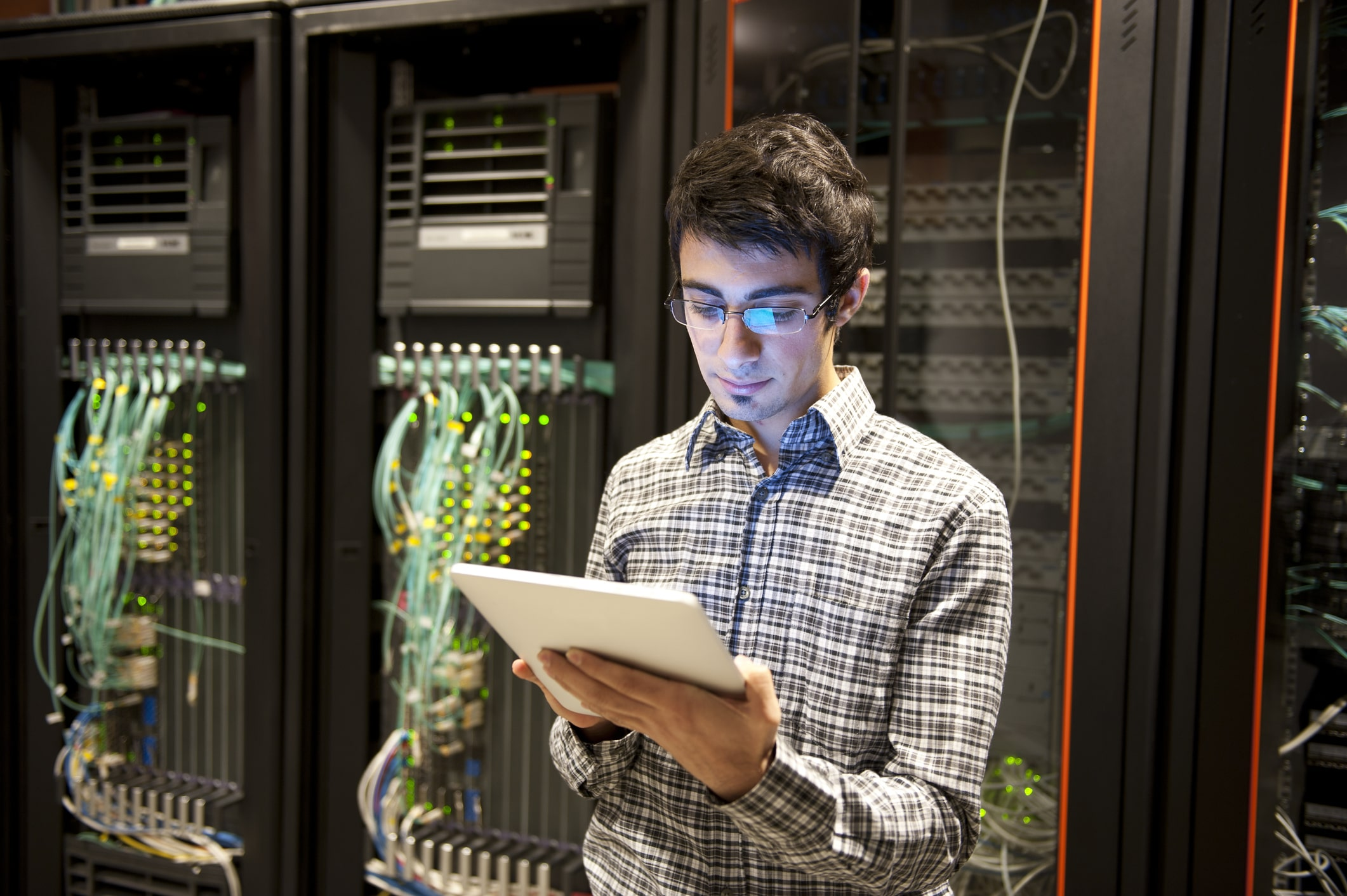 male network administrator in server room