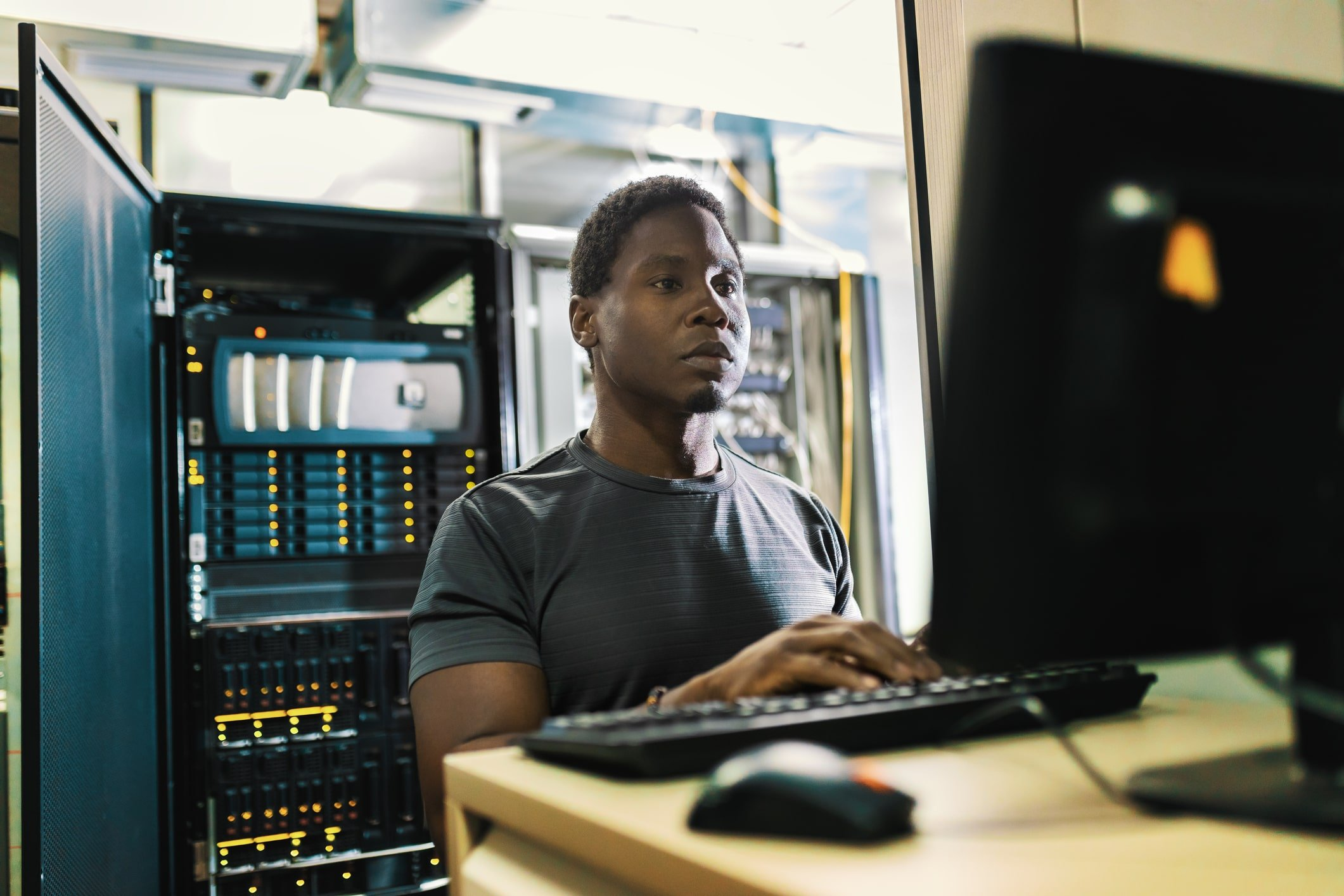 male network administrator working on computer